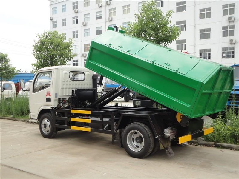 缸带动拉臂,对垃圾斗拉上或拉下,这两种车型都适合在城市的垃圾中转站图片